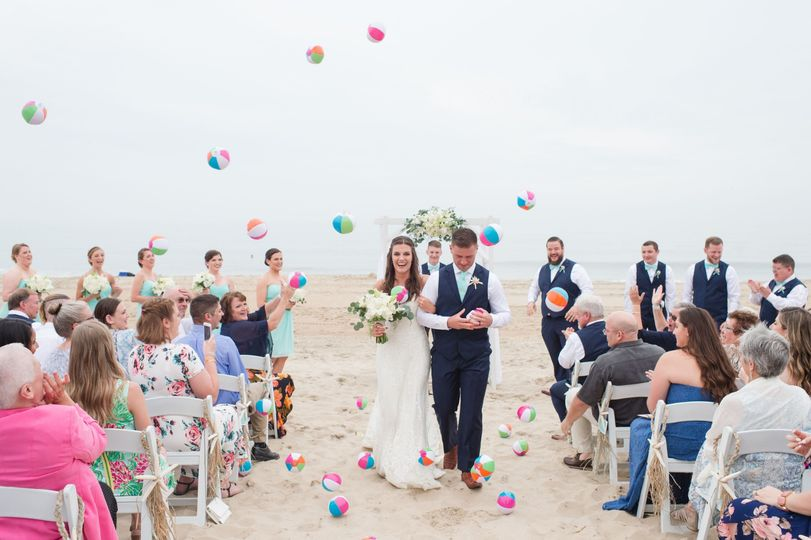Happily wed couple on the beach