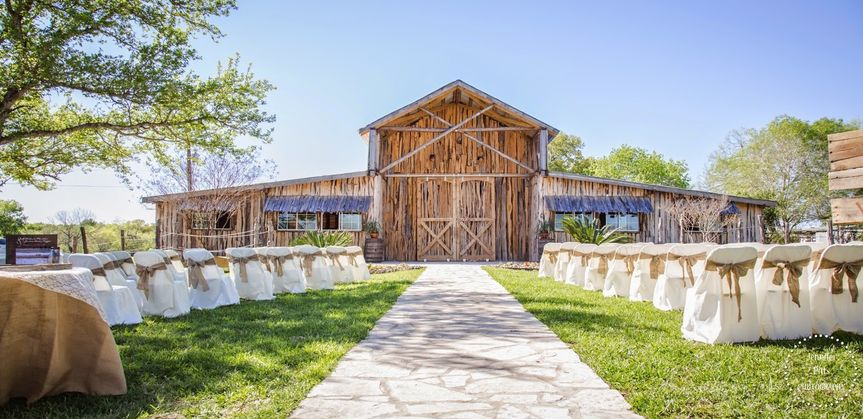 Ceremony in front of barn
