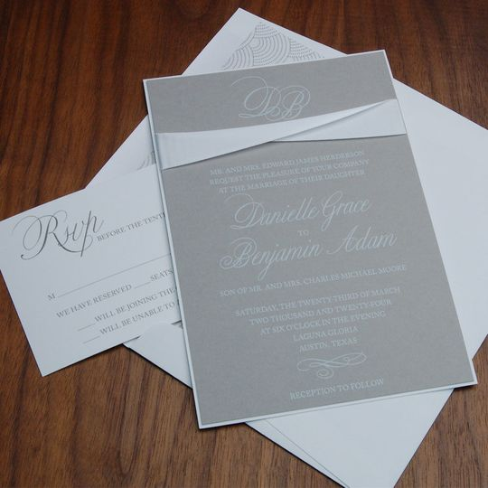 Beautiful soft grey and white paper and white ribbon band.