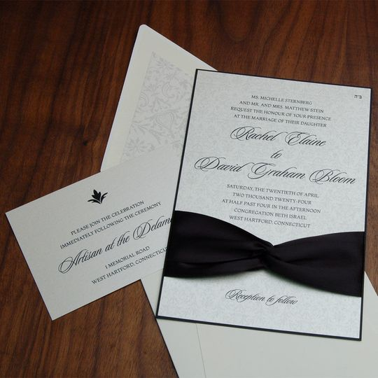 Black and white elegant wedding invite with ribbon sash.