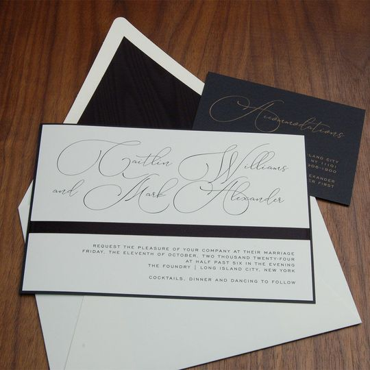 Exquisite new fonts highlight bride and groom's names, horizontal black ribbon separates names from...