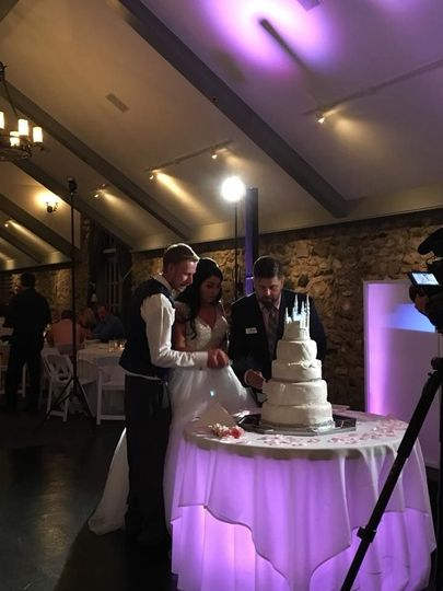 Thomas assists with the cake cutting ceremony