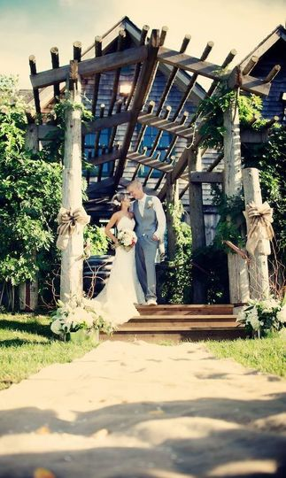 Ceremony with the barn as a backdrop