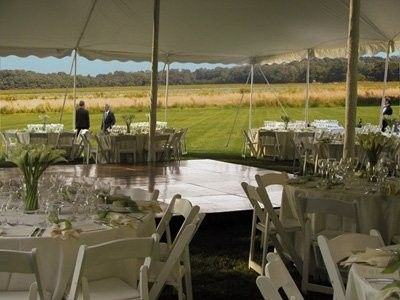 Tent with a view of the farm behind
