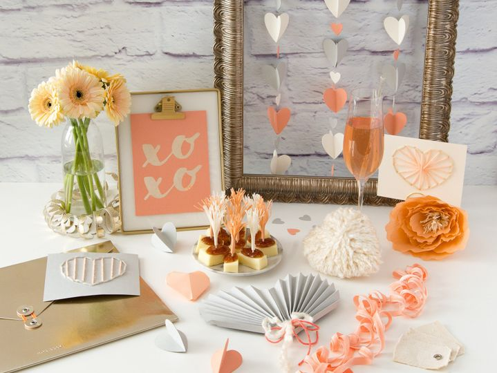 XOXO sign would make beautiful table numbers and the heart fan is great for summer weddings!
