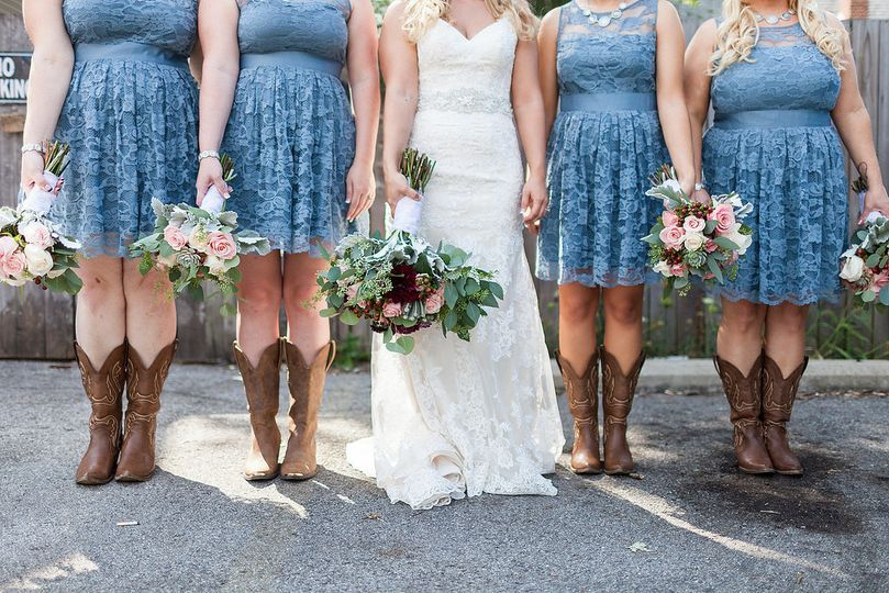 The bride and her bridesmaids holding their bouquet