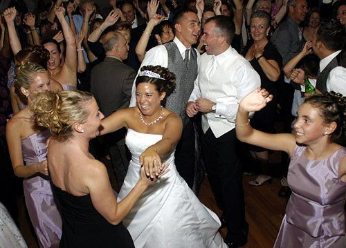 Bride and her guests dancing