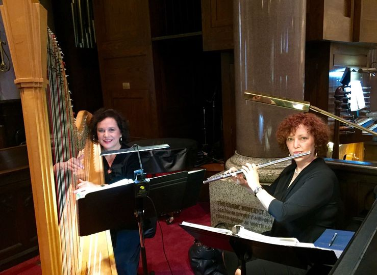Laura Byrne's Flute & Harp Duo at a church wedding ceremony.