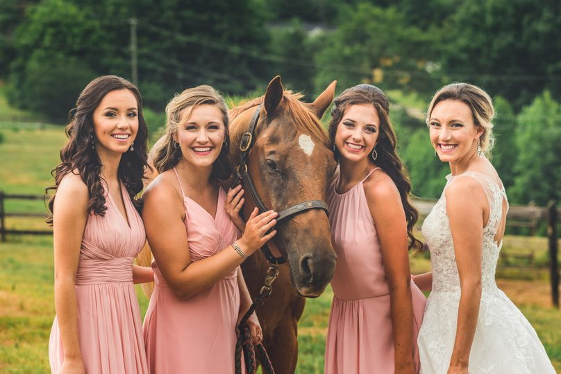 Bride and bridesmaids with the horse