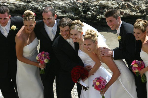 Destinations wedding.  Bridal party with bouquets made of pinks and purples.
