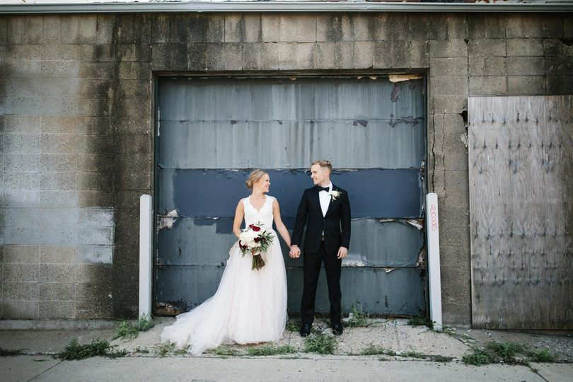 Newlyweds by the garage door