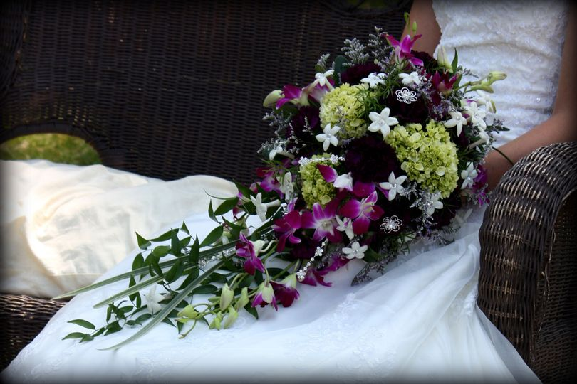Stephanotis, hydrangea, orchids, carnations and gems in a waterfall cascading bouquet.