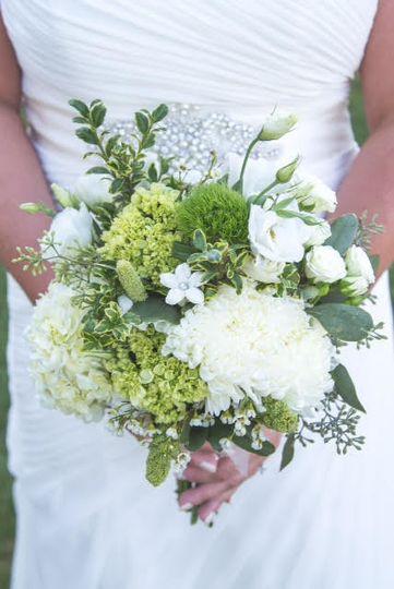 Organic handtied bouquet of hydrangea, lisianthus, stephanotis, roses and mums.