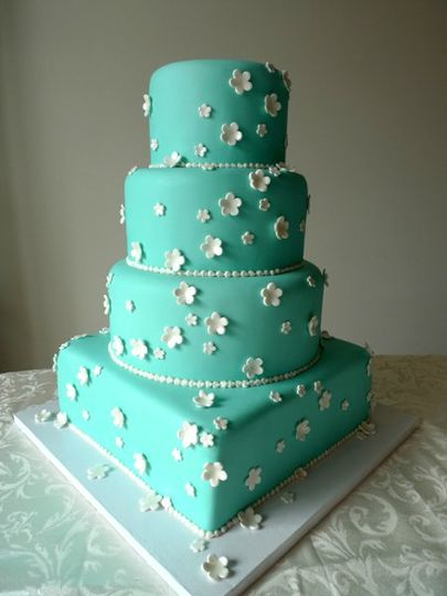 "Tiffany blue cake adorned with white blossoms.  The cake sizing is Round 6"",8"" and 10"" and square..."