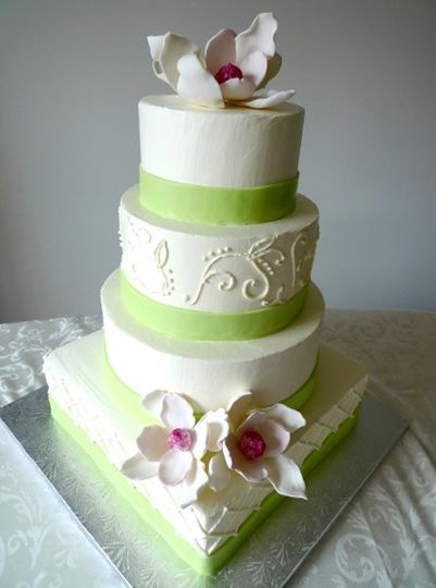 Ivory Buttercream cake with green and magenta accents.  The cake is topped with handmade sugarpaste...