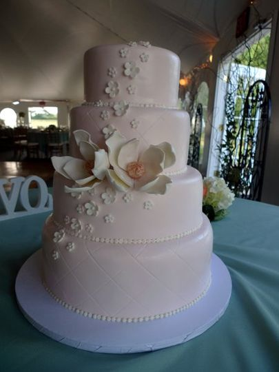 Pretty in Pink Magnolia Cake.  Cake is decorated in pale peachy pink with quilting border.  The cake...