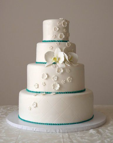 "Elegant white and teal fondant cake! The cake sizing is Round 4"", 6"", 9"" and 12"" tiers and the cake..."