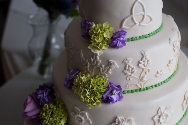 Celtic Ivory fondant wedding cake!  The cake is adorned with a different Celtic theme on each tier -...