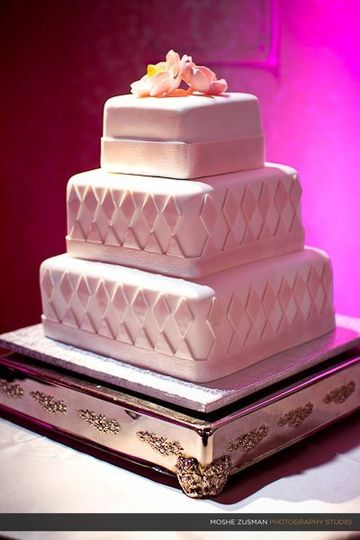 "Sleek Modern diamond white fondant cake!  The cake sizing is Square 6"", 9"" and 12"" and the cake..."