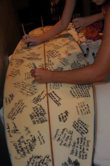 Surfboard guest book! We bought a used one from a local surf shop, cleaned it up, and provided...