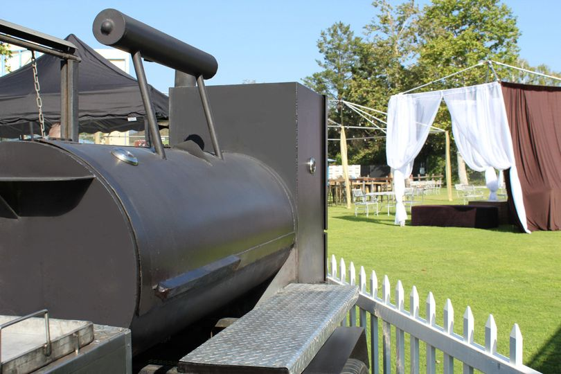 Our rustic tow behind smoker (optional) looks great at almost any event.