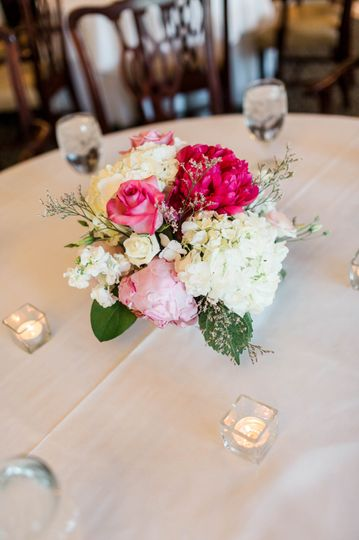 Hydrangeas, roses and peonies complete the centerpieces
