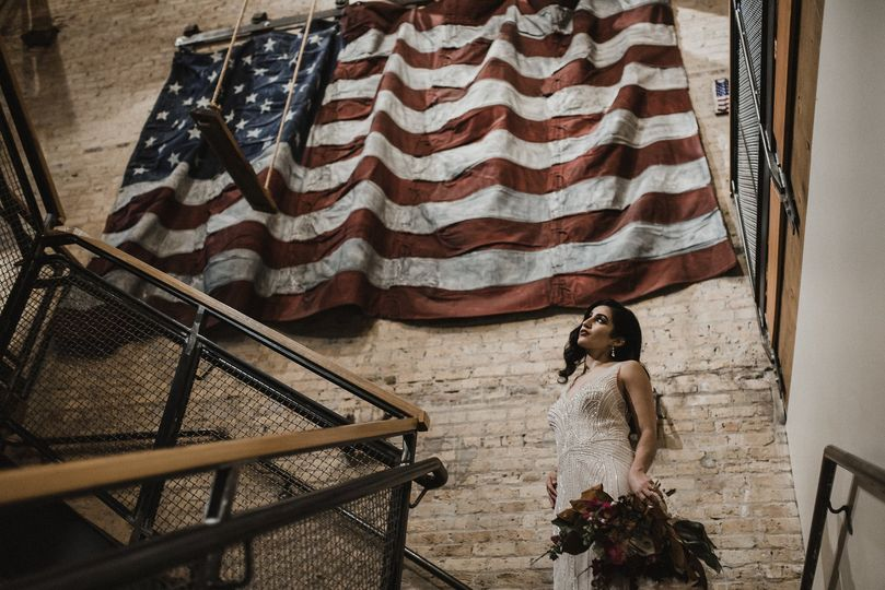 bride in front of flag roost photography
