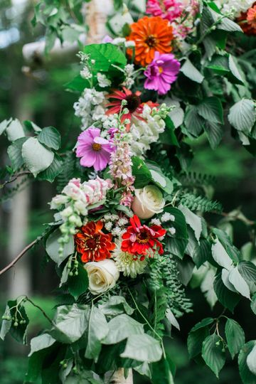 Create your own look by adding your flowers to the birch arbor