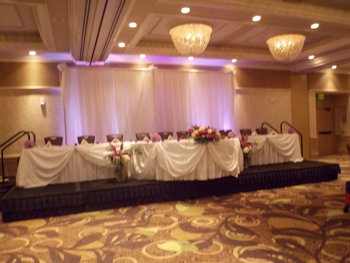 This beautiful back drop and head table at the Crowne Plaza of Lansing.  The subtle lighting and...