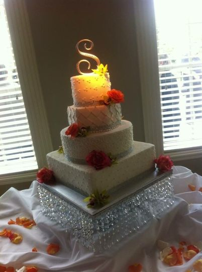 Four tier cake with red roses