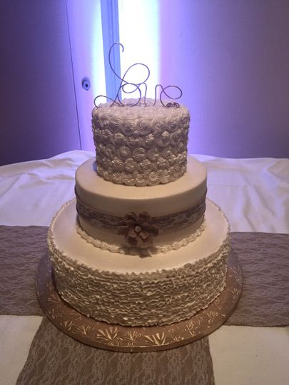 Three tier cake with love on tip
