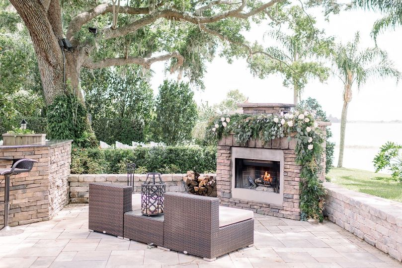 Lakeside terrace with fireplace