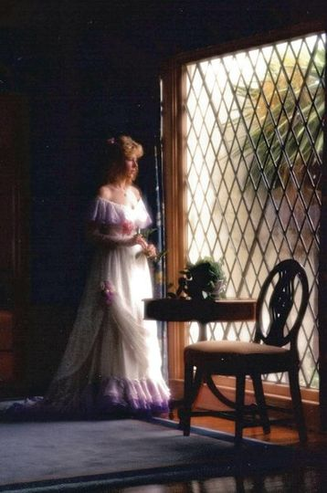 Historically inspired Romantic, Chantilly- covered, chiffon gown with sweep train, accented with...