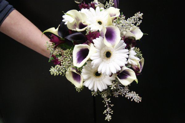 Wedding Bouquet of Calla lilies, gerbera daisies, seeded eucalyptus, and alstromeria.