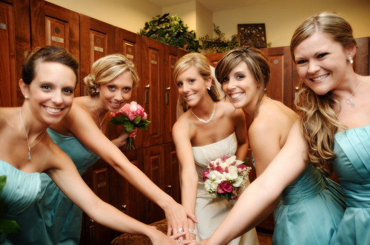 Group huddle with bridesmaids