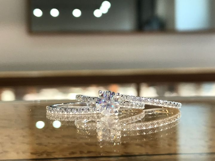 Custom Design, Classic prong set diamond engagement ring with a round center and two matching...