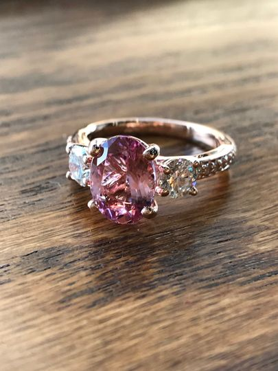 Custom Design: Three Stone Rose Gold Engagement ring with a oval Morganite center, two side...