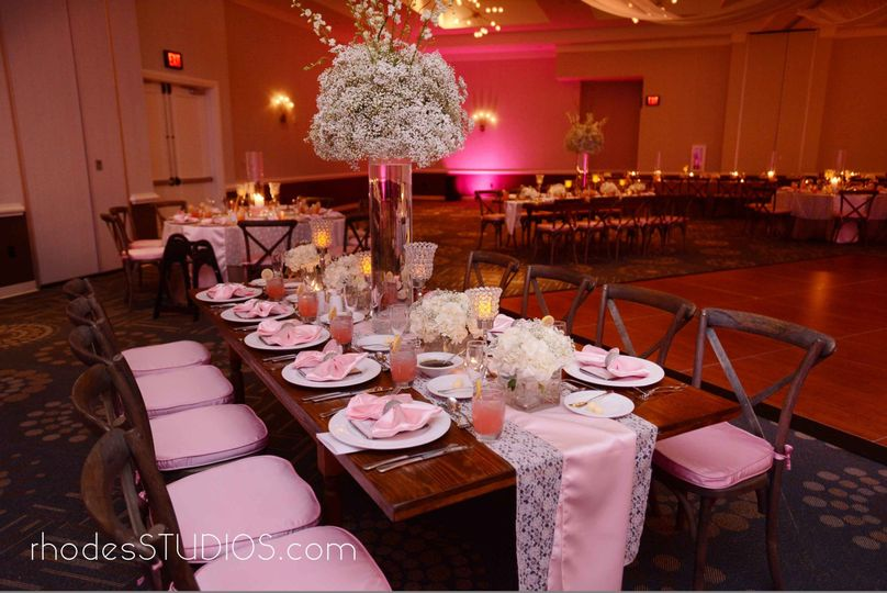 Elegant table scape and family style seating at 1805 on the Boulevard located in the Walt Disney...