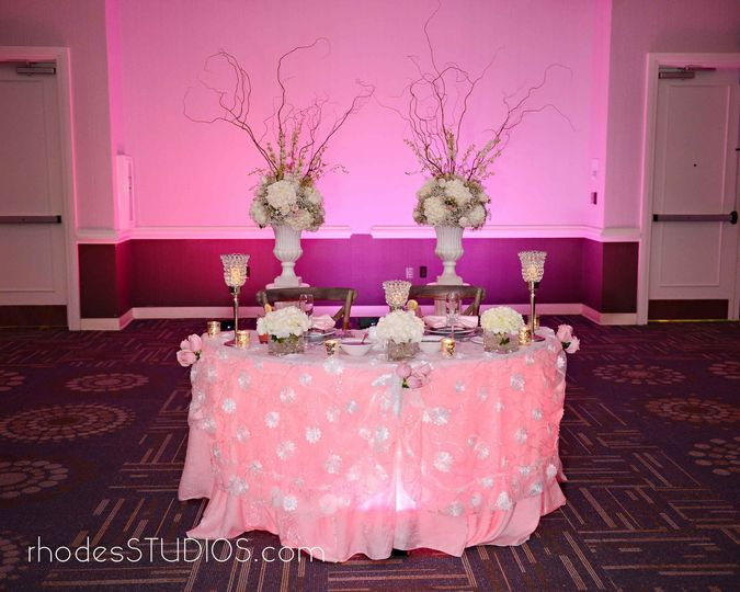 Elegant sweetheart table at 1805 on the Boulevard located in the Walt Disney World Resort. Call...