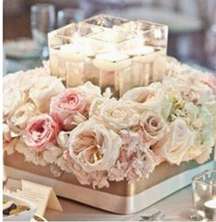 Romatic and intimate centerpiece in blush and white roses.