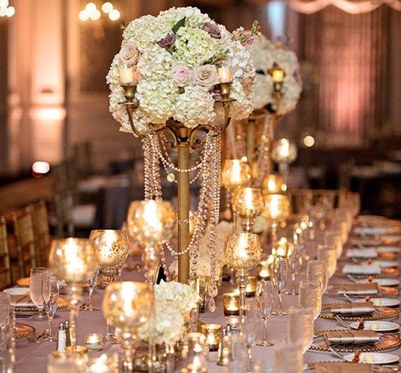 Floral and candle decor lined up for a rectangular table setting.
