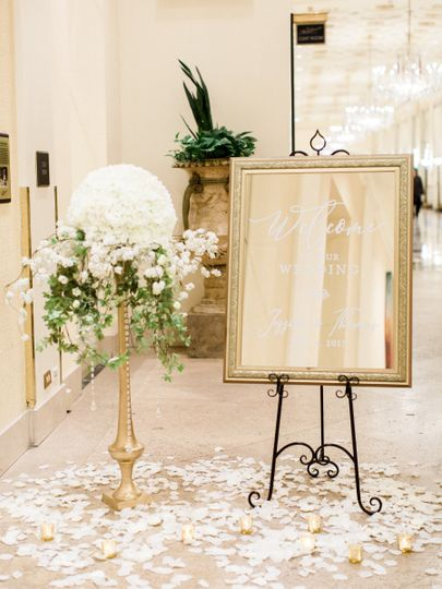 A wow floral arrangement with a welcome mirror at the entrance.