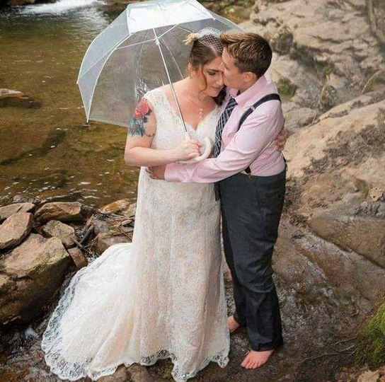 Happy the bride rain falls on