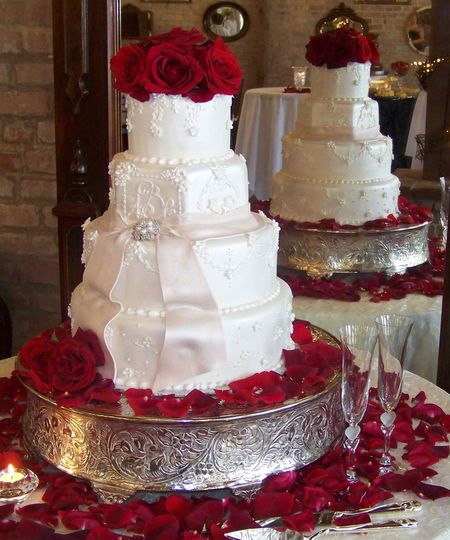 White cake with red rose decorations