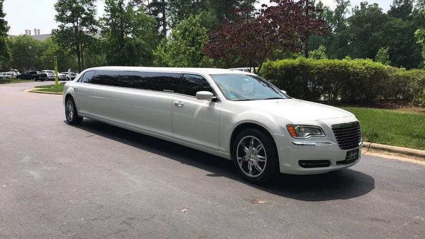Our Brand New White Chrysler 300 Stretch Limousine. Holds 9-10 passengers. She is a Beauty!