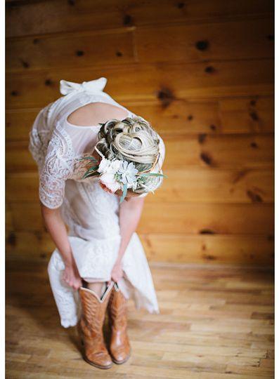 bride wearing boots on wedding day colorado