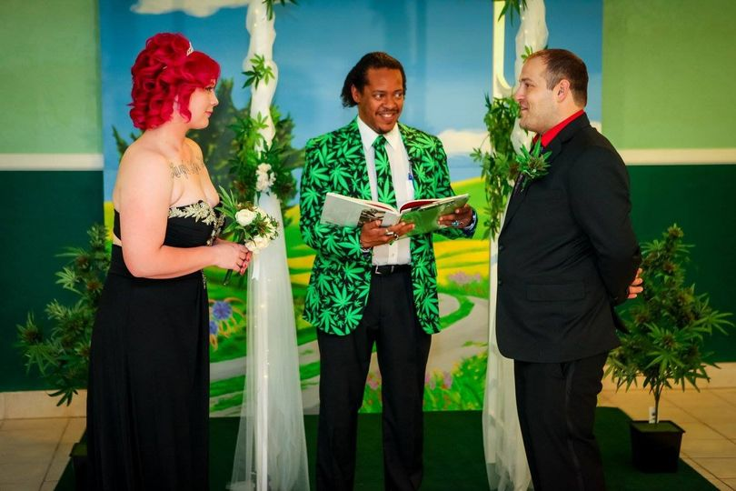 bride and groom with minister