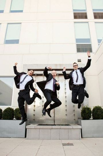 Jumps shot of the groom and groomsmen
