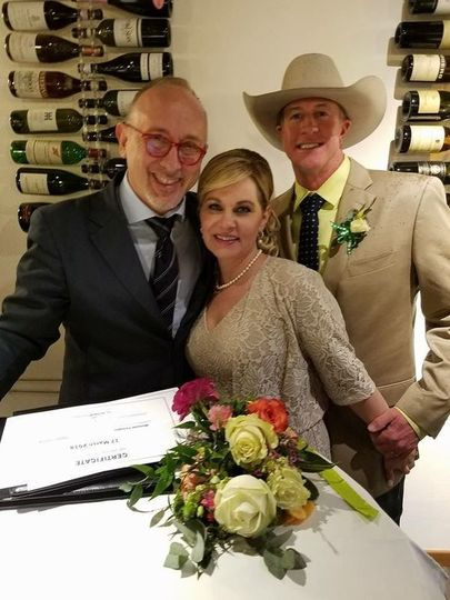 Officiant's photo with the newlyweds
