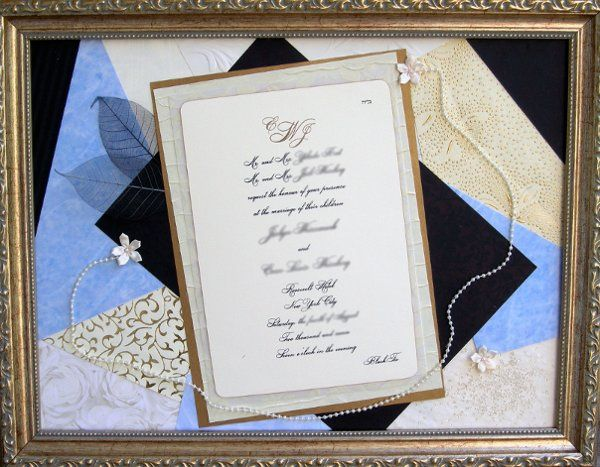 In this framed wedding invitation, sky blue was selected as the accent color for this elegant cream,...
